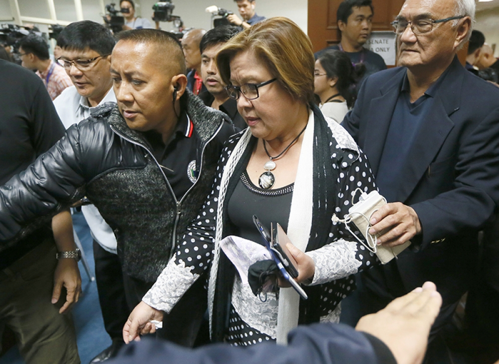 De Lima arrives at Camp Crame after arrest