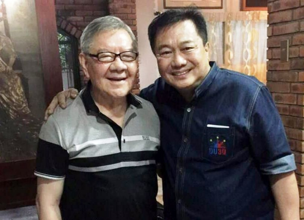 Speaker Feliciano Belmonte Jr. and his expected successor, Davao del Norte Rep. Pantaleon Alvarez share a light moment during Alvarez's visit to Belmonte's house in Quezon City on Thursday.