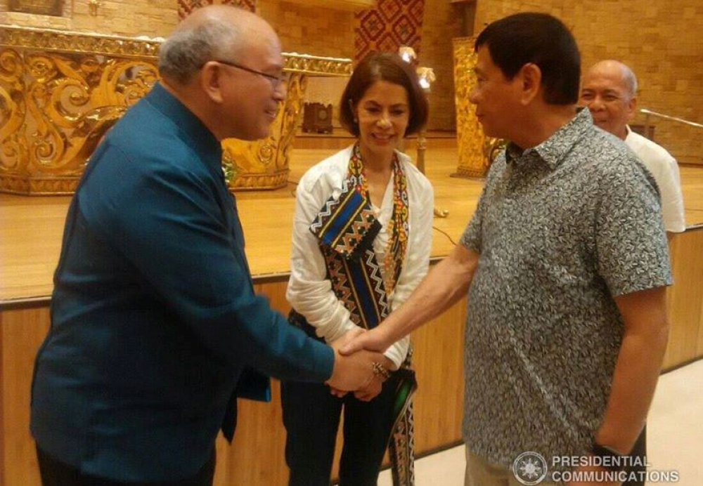 President Duterte shakes hands with Ateneo De Davao President Fr. Joel Tabora S.J. during his visit to the University on August 4, 2016. Also in the photo is DENR Secretary Gina Lopez. (SIMON PASUENGOS/STRATCOM, File)