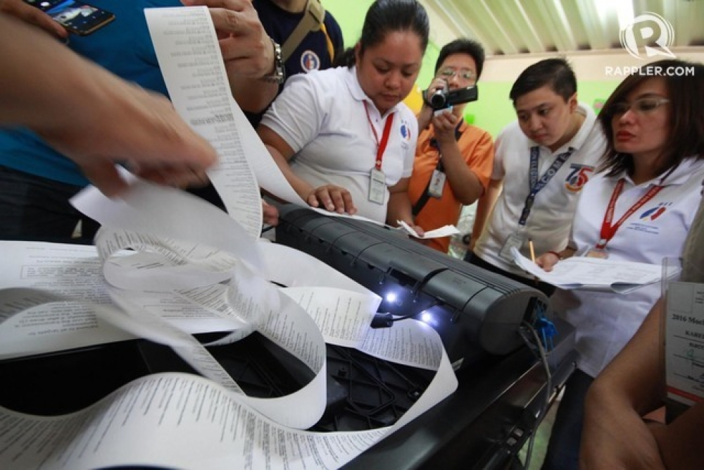 MOCK ELECTIONS. Board of Election Inspectors (BEI) in Bagong Pag-asa Elementary School in Quezon City remove election results after transmitting.